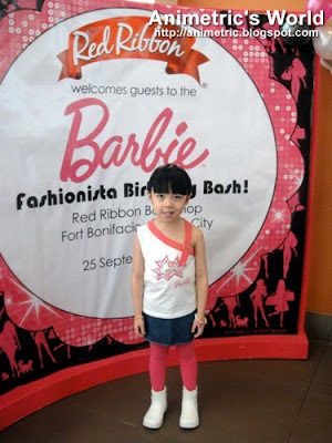 In pink Barbie clothes