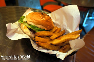Black Angus Burger with Fresh Fries at Charlie's Grind & Grill